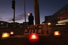 A woman holds a candlelit vigil outside University Hospital Galway in Ireland (Reuters)