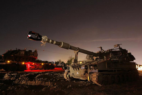 An Israeli tank just outside the northern Gaza Strip (Reuters)
