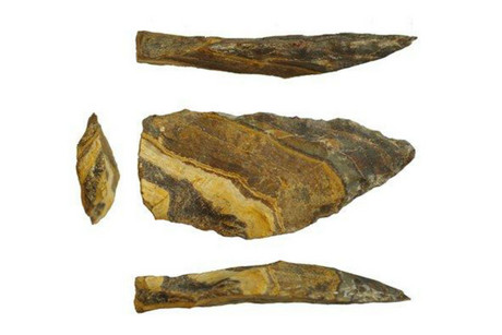 Different angles of an estimated 500,000-year-old stone point from Kathu Pan, South Africa