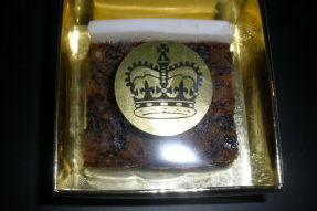 The cake comes in a golden-coloured box, complete with royal seal