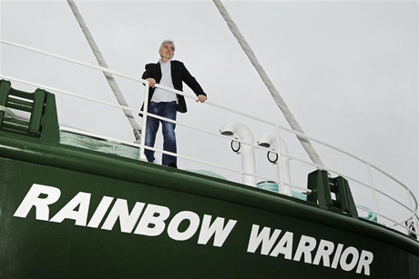 Executive director of Greenpeace UK John Sauven poses on the deck of the Greenpeace ship Rainbow Warrior III (Reuters)