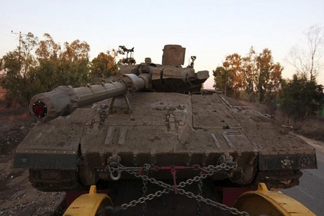 A truck transports a tank at an Israeli military base just outside the central Gaza Strip (Reuters/Amir Cohen)