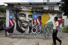 A man walks past graffiti artwork welcoming Barack Obama in Yangon, Myanmar