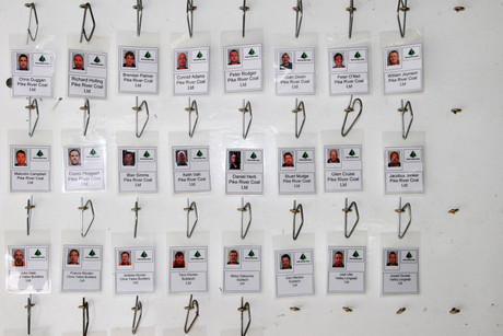 The tag board containing photo tags of the workers trapped in the Pike River mine (AAP)