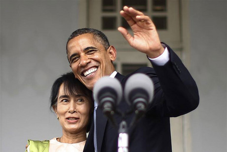 US President Barack Obama (R) waves with Aung San Suu Kyi (Reuters)