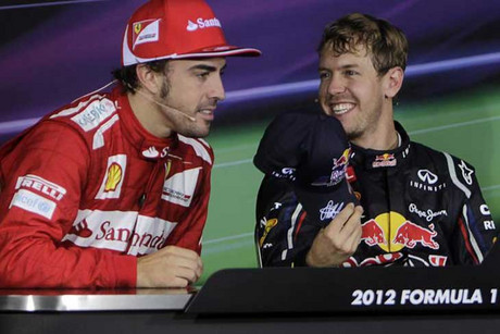 Ferrari's Fernando Alonso, left, with Red Bull's Sebastian Vettel (Reuters file)