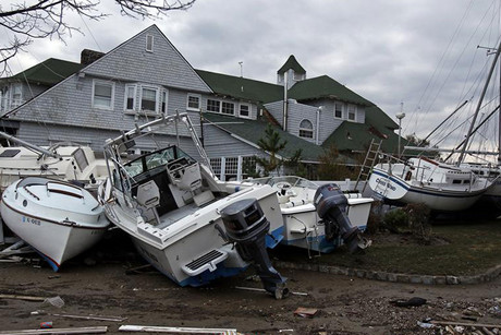 Boats damaged by Hurricane Sandy are seen in Sea Bright, New Jersey (Reuters)