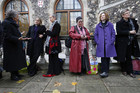 Female clergy members wait for the Church of England vote (Reuters)
