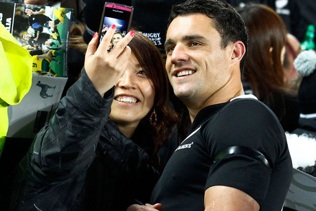 Dan Carter always answers requests for photos at airports whatever the time of day (file pic) 