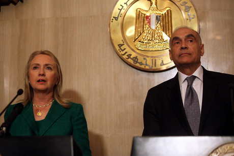 US Secretary of State Hillary Rodham Clinton (L) and Egyptian Foreign Minister Mohammed Kamel Amr (R) announce the cease-fire in Cairo, Egypt (AAP)