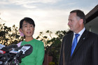 Burma's opposition leader Aung San Suu Kyi (left) and Prime Minister John Key (AAP)