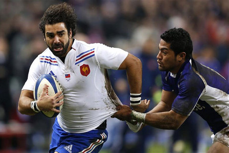 Samoa's Robert Lilomaiava struggles with France's Yoann Huget (Reuters)