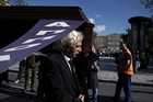 Municipal workers carry a coffin during a demonstration against Greece's austerity measures (AAP)