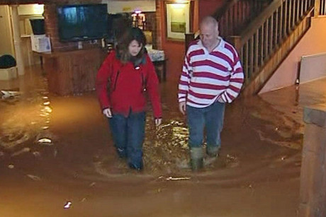 British residents wade through the floodwaters