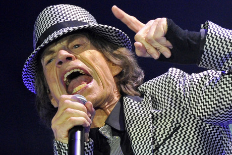 Mick Jagger performs with the Rolling Stones at the O2 Arena in London (Reuters/Toby Melville)