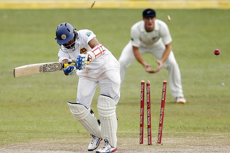 Sri Lanka's Tillakaratne Dilshan, left, is bowled out by New Zealand's Tim Southee (Reuters)