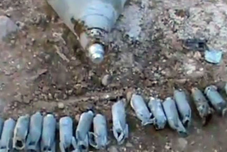 An image grab taken from activists video, made available through the SRCC (Syrian Research and Communication Centre), shows cluster bombs allegedly used by Syrian security forces on the town of Deir al-Asafir, East Ghouta District, Damascus Province (AAP/EPA)