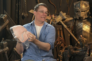 Sir Richard holds one of the hundreds of silicon masks used to make the film