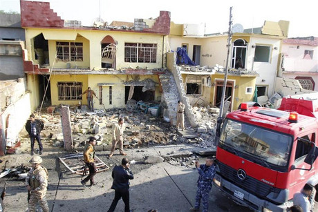Security personnel inspect the site of a car bomb attack in Kirkuk (Reuters)