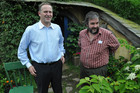 Prime Minister John Key (left) and director Sir Peter Jackson walk around the set of the film The Hobbit near the town of Matamata (AAP)