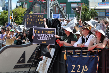 Protest signs at the edge of the red carpet entrance to 'The Hobbit' premiere (AAP)