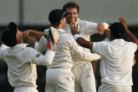 Doug Bracewell celebrates with BlackCaps team mates after taking a wicket against Sri Lanka (Reuters)