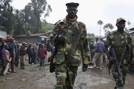 M23 rebel fighters walk in the town of Karuba, some 62km west of Goma (Reuters)