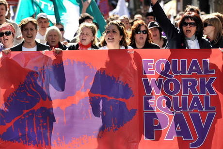 Protestors take part in an 'Equal Pay' rally in Sydney (AAP)