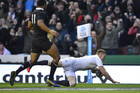 England's Chris Ashton (R) scores a try against New Zealand (Reuters)