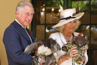 Prince Charles and Camilla Parker-Bowles holding koalas during their visit to Australia (AAP)