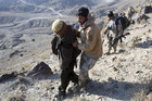 Afghan border policemen escort a detained suspected Taliban fighter (Reuters)