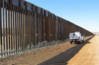 A border patrol vehicle observes six miles of border fencing in Douglas, Arizona (Reuters)