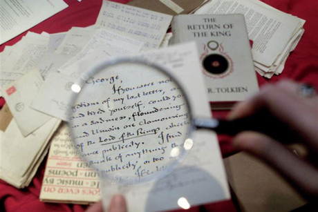 A magnifying glass shows details of a letter sent by British author J.R.R. Tolkien to his friend George Sayer (Reuters)