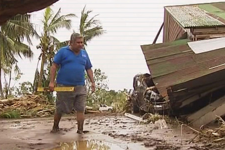Rudy Bartley surveys the damage in Lelata, Samoa, just outside of Apia