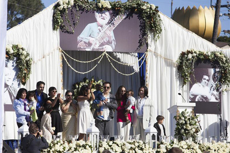 Family members of Ravi Shankar address the crowd during the service  (Reuters)