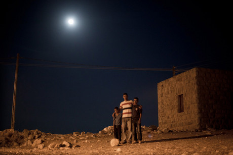 Shepherd Mansour (centre) with two boys on the outskirts of Bethlehem (Photo: Tim Parsons)