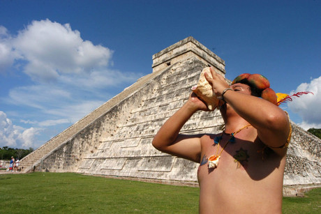 An indigenous plays a shell at Chichen Itza (AAP)