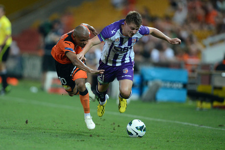 Brisbane Roar's Henrique (left) fights for the ball with Perth Glory's Scott Jamieson (AAP)