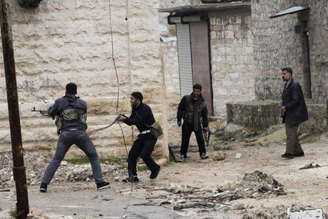 Free Syrian Army fighters return fire during clashes near Aleppo this week  (Reuters)