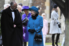 Britain's Queen Elizabeth (C) speaks with Reverend Jonathan Riviere (L) outside of St. Mary's church after attending the annual Christmas service on the Royal Estate at Sandringham in Norfolk, eastern England (Reuters)
