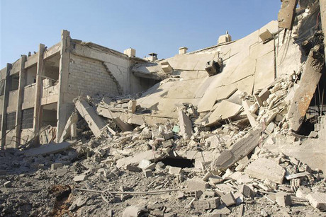 Buildings in Daria near Damascus damaged by what activists said were missiles fired by the Syrian Air Force (Reuters)