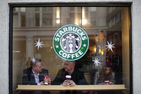 Starbucks says it is reviewing its UK tax practices (Reuters)