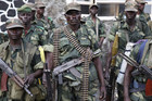 Government army FARDC soldiers stand in a military base in Goma (Reuters)