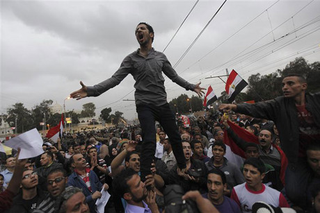 Anti-Morsi protesters shout slogans during a protest in front of the presidential palace in Cairo (Reuters)