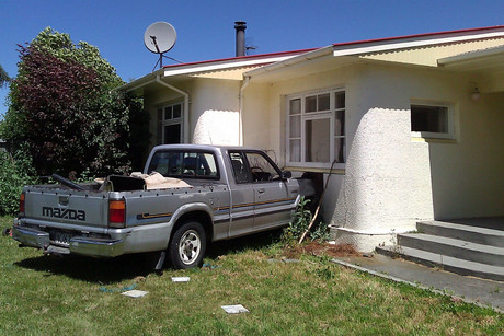 The car ran into a house in Kaiapoi's Sewell Street (Christie Douglas / 3 News)