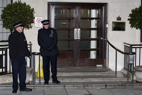 Police officers stand outside the King Edward VII hospital in central London (Reuters)