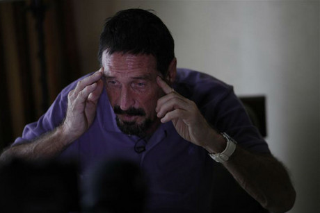 John McAfee, anti-virus software guru, gestures as he speaks during an interview in Guatemala City (Reuters)