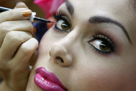 Aleika Barros of Brazil applies makeup in the dressing room before competing in the Miss International Queen 2007 transsexual beauty pageant (Reuters)
