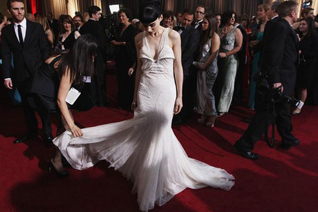 Actress Rooney Mara adjusts her dress at the Academy Awards