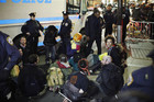 Members of the Occupy Wall St movement are arrested by NYPD officers (Reuters